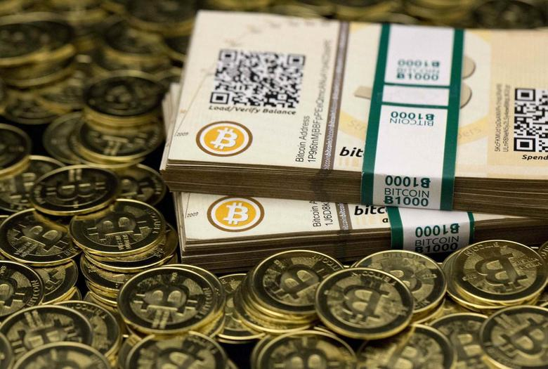 Some of Bitcoin enthusiast Mike Caldwell's coins and paper vouchers, often called ''paper wallets'', are pictured at his office in this photo illustration in Sandy, Utah, January 31, 2014. REUTERS/Jim Urquhart REUTERS/Jim Urquhart