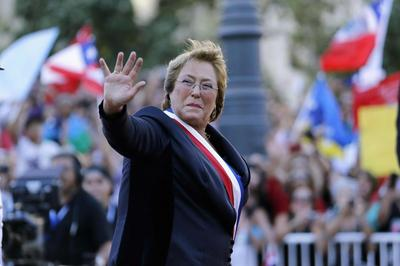 Bachelet takes power in Chile, vows to fight inequality