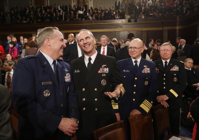 Members of the joint chiefs of staff, Air Force Chief of Staff, General Mark Welsh (L); Chief of Naval Operations, Admiral Jonathan W. Greenert (2nd from L); Commandant of the Coast Guard, Admiral Robert J. Papp, Jr.; and Chief of the National Guard Bureau, General Frank J. Grass (R); await the start of President Barack Obama's State of the Union speech on Capitol Hill in Washington, January 28, 2014. REUTERS/Larry Downing