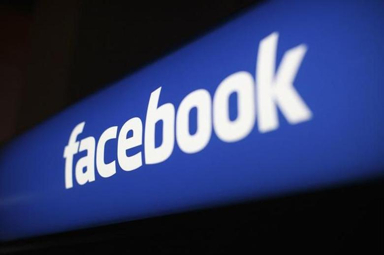 The Facebook logo is pictured at the Facebook headquarters in Menlo Park, California January 29, 2013. REUTERS/Robert Galbraith/Files