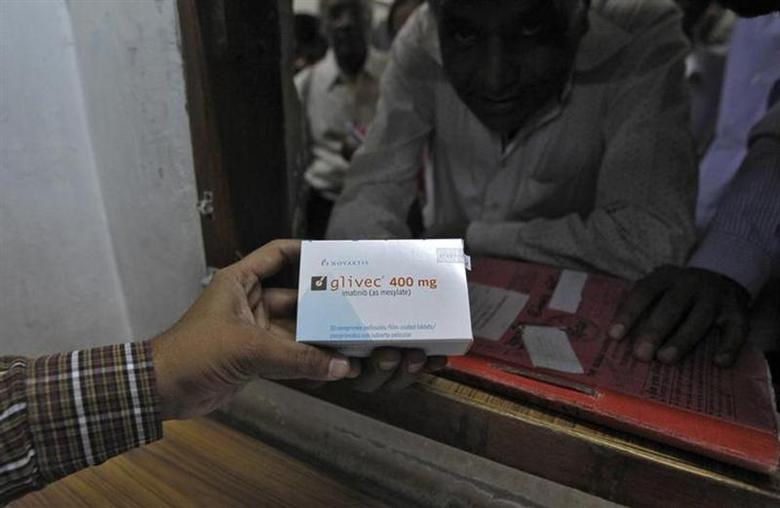 A man buys cancer drug Glivec for a relative who is suffering from cancer at a pharmacy in a government-run hospital in Ahmedabad April 2, 2013. REUTERS/Amit Dave/Files