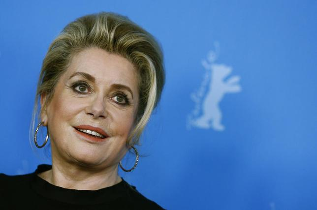 Cast member Catherine Deneuve poses during a photocall to promote the movie ''Dans La Cour (In the Courtyard)'' at the 64th Berlinale International Film Festival in Berlin February 11, 2014. REUTERS/Thomas Peter