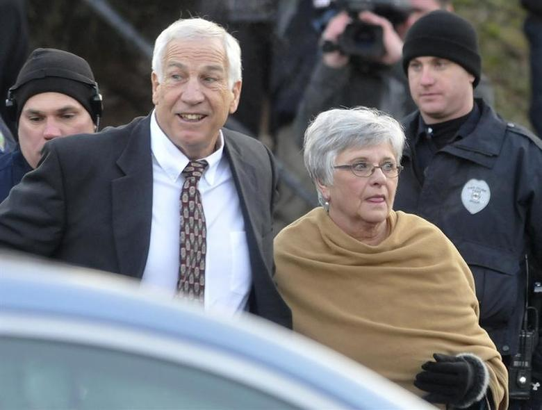 Former Penn State assistant football coach Jerry Sandusky (L) and his wife Dottie arrive for a preliminary hearing to determine if there is enough evidence to hold him for trial on charges of sexually abusing boys, at the Centre County Courthouse in Bellefonte, Pennsylvania, December 13, 2011. SREUTERS/Pat Little
