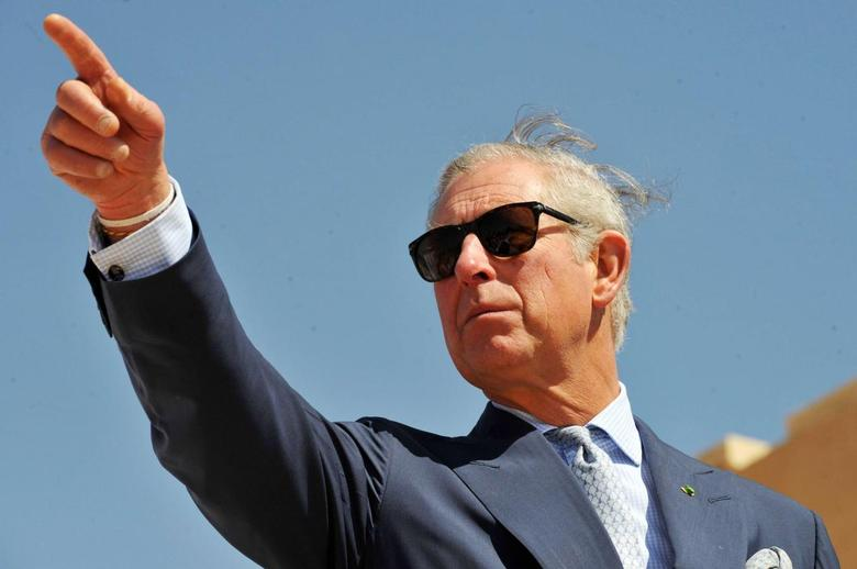 Britain's Prince Charles gestures during a visit to a historical site under reconstruction in Al-Diriyah February 19, 2014. REUTERS/Fayez Nureldine/Pool