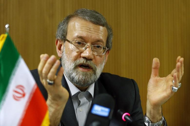 Ali Larijani, Speaker of the Iranian Parliament, gestures during a news conference after the 129th Assembly of the Inter-Parliamentary Union in Geneva October 9, 2013. REUTERS/Denis Balibouse