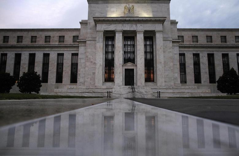 The facade of the U.S. Federal Reserve building is reflected on wet marble during the early morning hours in Washington, July 31, 2013.. REUTERS/Jonathan Ernst