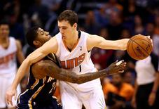 Jan 22, 2014; Phoenix, AZ, USA; Phoenix Suns guard Goran Dragic (right) controls the ball against Indiana Pacers forward Paul George in the second half at US Airways Center. Mandatory Credit: Mark J. Rebilas-USA TODAY Sports