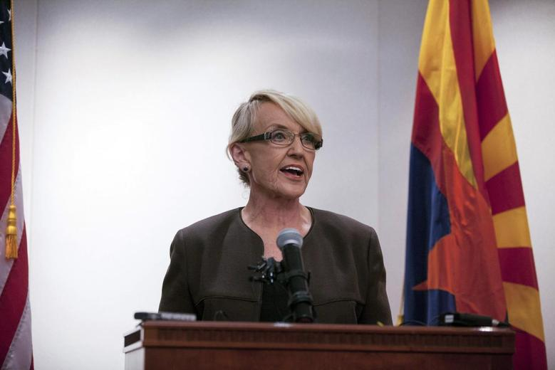 Arizona Governor Jan Brewer makes a statement saying she vetoed the controversial Senate Bill 1062 bill, at Arizona State Capitol in Phoenix February 26, 2014. REUTERS/Samantha Sais