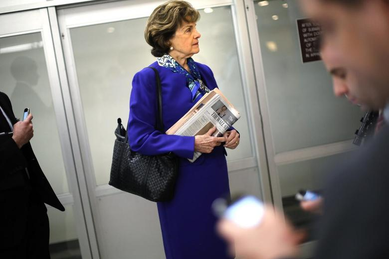 U.S. Senator Dianne Feinstein (D-CA) waits for a subway car with aides as she returns to her office after a floor speech aimed at the CIA's handling of documents related to the Senate Intelligence Committee, at the U.S. Capitol in Washington March 11, 2014. REUTERS/Jonathan Ernst