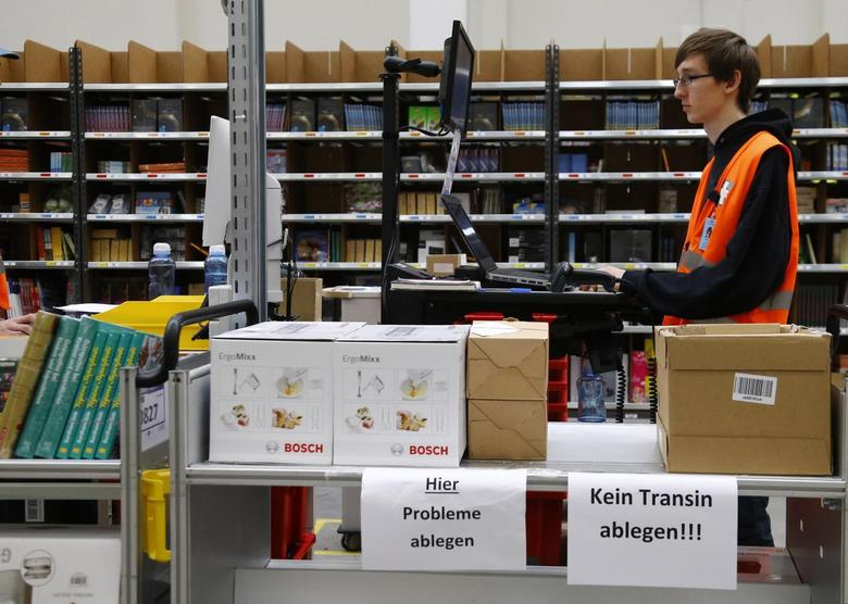 A worker stands at his workspace as he supervises items for delivery from the 70,000 square metre warehouse floor at Amazon's new distribution center in Brieselang, near Berlin November 28, 2013. REUTERS/Tobias Schwarz