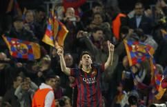 Barcelona's Lionel Messi celebrates after scoring a goal against Manchester City during their Champions League last 16 second leg soccer match at Camp Nou stadium in Barcelona March 12, 2014. REUTERS/Albert Gea