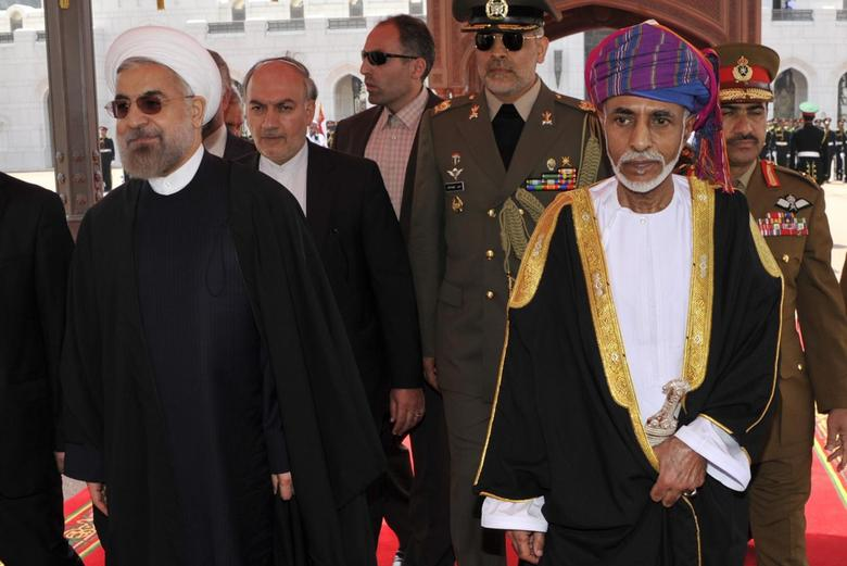 Oman's Sultan Qaboos bin Said (R) walks with Iran's President Hassan Rouhani upon Rouhani's arrival in Muscat March 12, 2014. REUTERS/Sultan Al Hasani