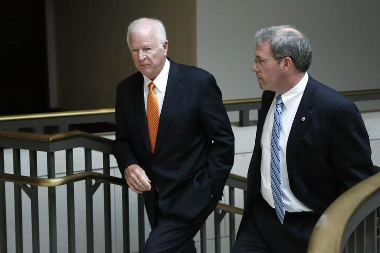 U.S. Senator Saxby Chambliss (R-GA) (L), vice chairman of the Senate Select Committee on Intelligence, and Senator Jeffrey Chiesa (R-NJ) depart after a full-Senate briefing by Director of the National Security Agency General Keith Alexander (not pictured), at the U.S. Capitol in Washington, June 13, 2013. REUTERS/Jonathan Ernst