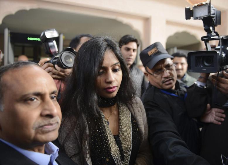 Indian diplomat Devyani Khobragade (C) leaves with her father Uttam Khobragade (L) from the Maharashtra Sadan state guesthouse to meet India's Foreign Minister Salman Khurshid in New Delhi January 11, 2014. REUTERS/Stringer