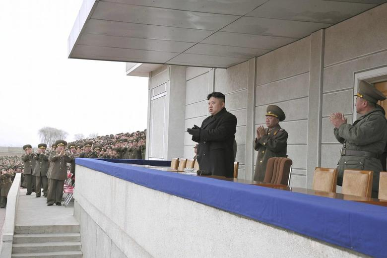 North Korean leader Kim Jong Un applauds as he guides a shooting contest of teaching staff of military universities in this undated photo released by North Korea's Korean Central News Agency (KCNA) March 12, 2014 . REUTERS/KCNA