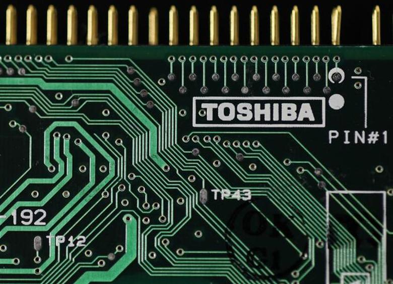 A logo of Toshiba Corp is seen on a printed circuit board in this photo illustration taken in Tokyo July 31, 2012. REUTERS/Yuriko Nakao/Files