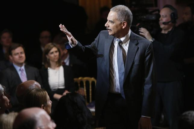 U.S. Attorney General Eric Holder arrives for a television taping of ''In Performance at the White House: Women of Soul'' in Washington March 6, 2014 file photo. REUTERS/Jonathan Ernst
