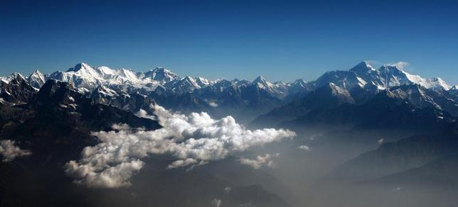 Mount Everest (2nd R), the world highest peak, and other peaks of the Himalayan range are seen from air during a mountain flight from Kathmandu April 24, 2010. REUTERS/Tim Chong