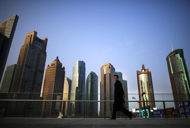 A man walks at the financial district of Pudong in Shanghai March 11, 2014. REUTERS/Carlos Barria