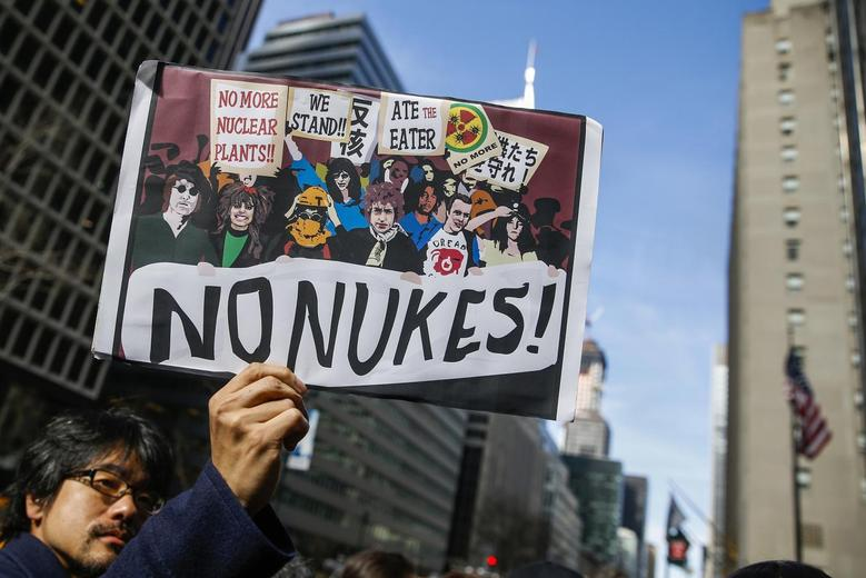 A demonstrator holds a sign during a protest against nuclear power on the anniversary of the March 11, 2011 Fukushima earthquake and tsunami that killed thousands in Japan, outside the Consulate of Japan in New York March 11, 2014. REUTERS/Shannon Stapleton