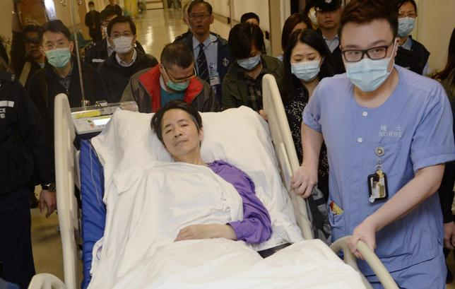 Ming Pao's former chief editor Kevin Lau, who was brutally attacked on Wednesday, is transferred to a private ward in Eastern Hospital after spending three days in intensive care in Hong Kong March 1, 2014. REUTERS/Stringer