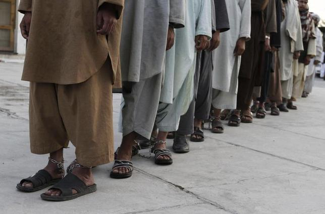 Prisoners who escaped from Kandahar's Sarposa jail on Monday are presented to the media after they were recaptured, in Kandahar April 26, 2011 file photo. REUTERS/Ahmd Nadeem