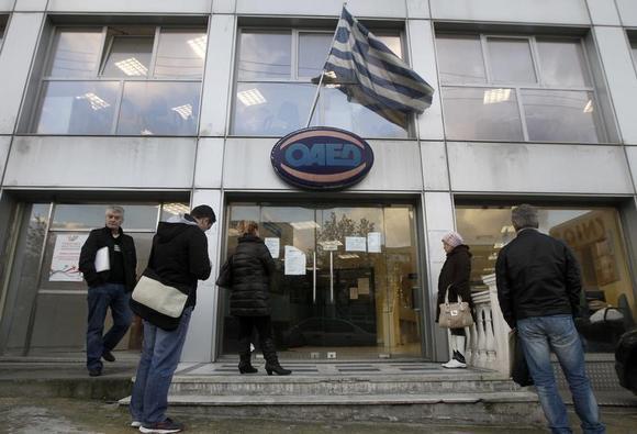 People wait outside a Greek Manpower Employment Organisation (OAED) office in an Athens suburb December 11, 2013. REUTERS/John Kolesidis