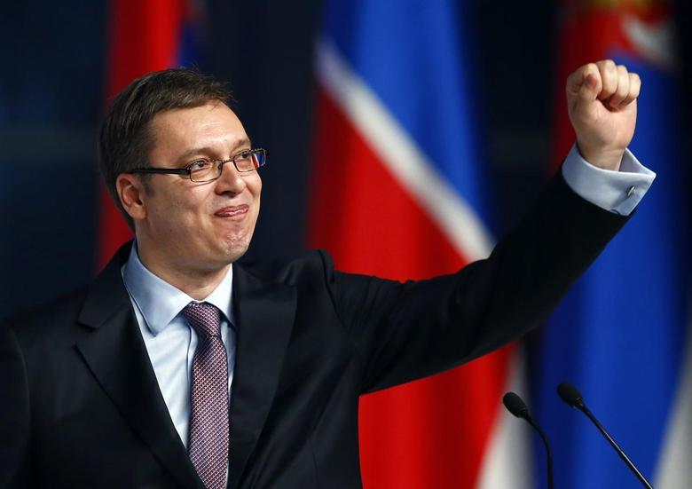 Serbian Deputy Prime Minister and the leader of Serbian Progressive Party (SNS) Aleksandar Vucic waves to his supporters during a rally in Belgrade March 11, 2014. REUTERS/Marko Djurica