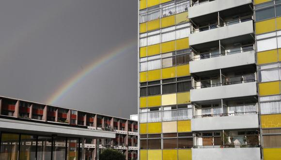A rainbow appears over a housing estate in east London March 3, 2014. REUTERS/Suzanne Plunkett