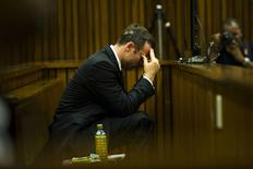 Olympic and Paralympic track star Oscar Pistorius sits in the dock during court proceedings at the North Gauteng High Court in Pretoria, March 13, 2014. REUTERS/Alet Pretorius/Media24/Pool