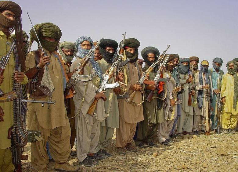 An undated photo shows Baluch rebels holding their weapons as they pose for a photograph at an undisclosed location in Pakistan's Baluchistan province. REUTERS/Stringer