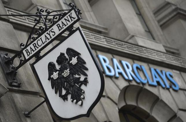 Logos are seen outside a branch of Barclays bank in London July 30, 2013. REUTERS/Toby Melville/Files