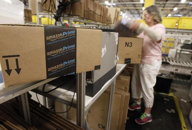 A worker prepares an item for Amazon Prime delivery at Amazon's distribution center in Phoenix, Arizona in this file photo taken November 22, 2013. REUTERS/Ralph D. Freso/Files