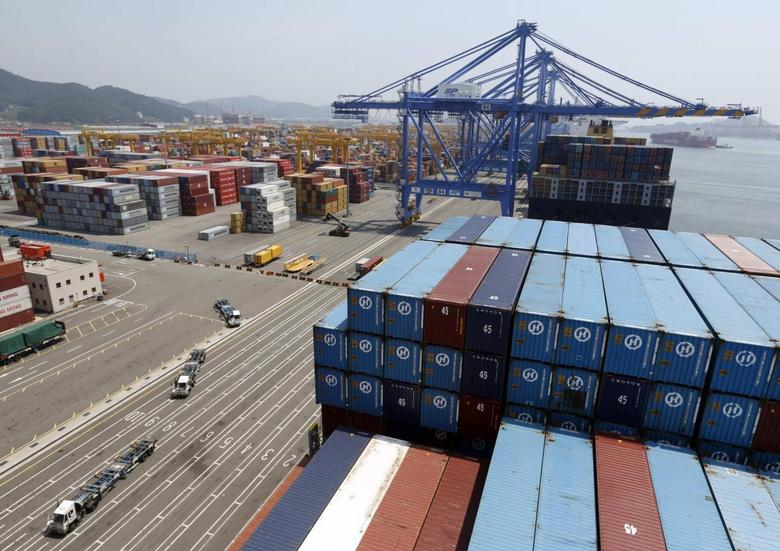 Trucks used to transport containers are seen at the Hanjin Shipping container terminal at the Busan New Port in Busan, about 420 km (261 miles) southeast of Seoul, August 8, 2013 file photo. REUTERS/Lee Jae-Won