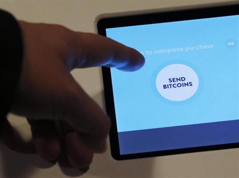 Hong Kong's first bitcoin ATM is seen during a demonstration at a bitcoin exchange in Hong Kong March 13, 2014. REUTERS/Bobby Yip