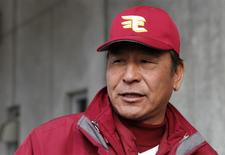 Yoshinori Sato, a pitching coach for the Rakuten Golden Eagles, speaks to reporters at Muscat Stadium in Kurashiki, western Japan March 8, 2014 file photo. REUTERS/Junko Fujita