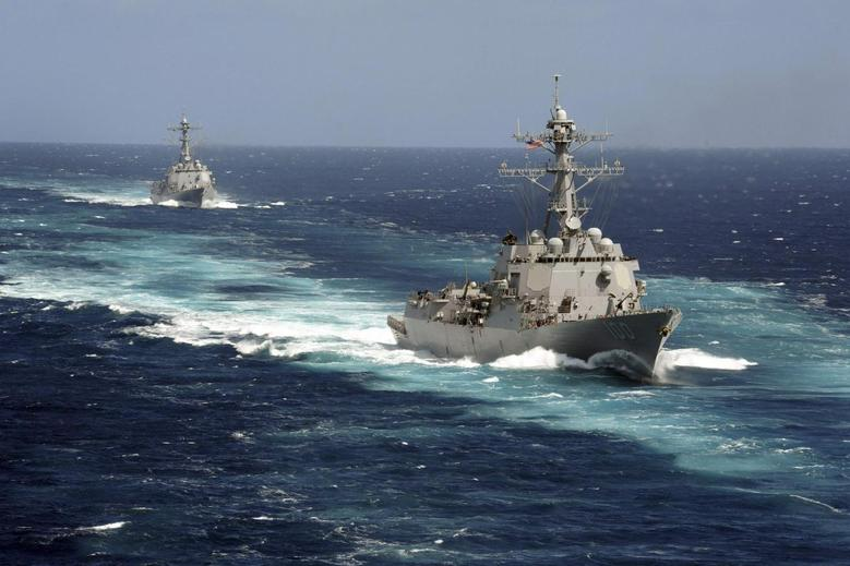 The Arleigh Burke-class guided-missile destroyers USS Kidd and USS Pinckney are seen en transit in the Pacific Ocean in this U.S. Navy picture taken May 18, 2011. Kidd and Pinkney have been searching for the missing Malaysian airliner and are being re-deployed to the Strait of Malacca of Malaysia's west coast as new search areas are opened in the Indian Ocean, according to officials on March 13, 2014. REUTERS/US Navy/Seaman Apprentice Carla Ocampo/Handout