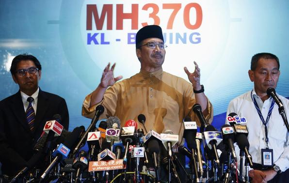 Malaysia's acting Transport Minister Hishammuddin Tun Hussein speaks during a news conference about the missing Malaysia Airlines flight MH370, at Kuala Lumpur International Airport March 14, 2014. REUTERS-Edgar Su