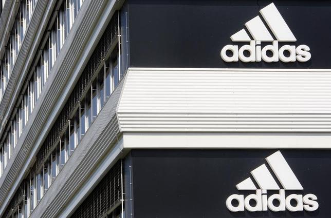 Adidias logos are seen on the company's building in Landersheim near Strasbourg March 31, 2009. REUTERS/Christian Hartmann