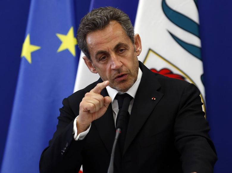 Former French President Nicolas Sarkozy gestures as he delivers a speech during the inauguration of the Institut Claude Pompidou, a new centre for care and research of Alzheimer disease, in Nice March 10, 2014. REUTERS/Eric Gaillard