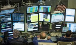 Traders work on the floor of the New York Stock Exchange March 11, 2014. REUTERS/Brendan McDermid