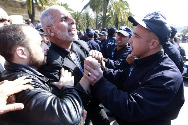 Members of an opposition party clash with riot police officers during a demonstration against Algerian President Abdulaziz Bouteflika's decision to run for a fourth term, in Algiers March 12, 2014. REUTERS/Louafi Larbi