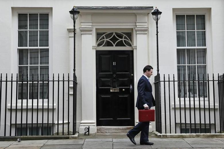 Britain's Chancellor of the Exchequer, George Osborne, walks away from number 11 Downing Street, before delivering his budget to the House of Commons, in central London March 20, 2013. OREUTERS/Stefan Wermuth