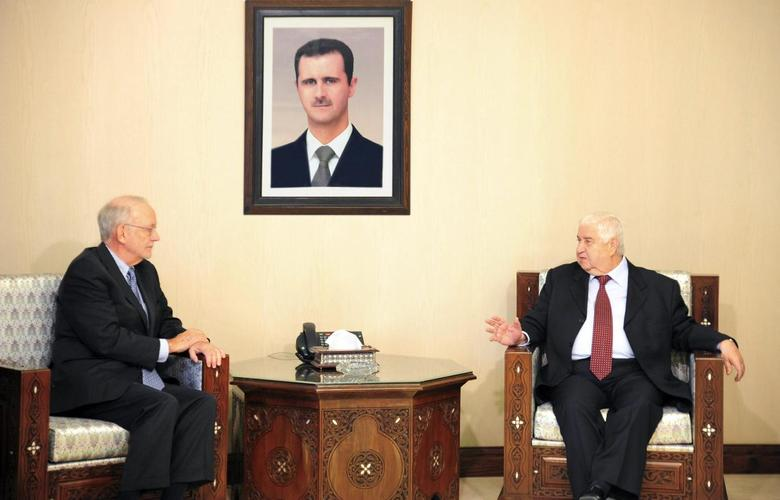 Syria's Foreign Minister Walid Moualem (R) meets United Nations Children's Fund (UNICEF) Director Anthony Lake in Damascus March 12, 2014, in this handout photograph released by Syria's national news agency SANA. REUTERS/SANA/Handout via Reuters