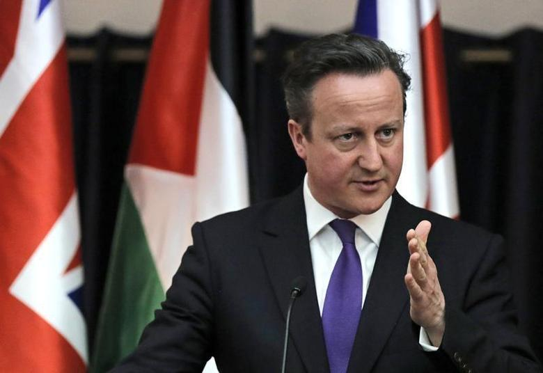 British Prime Minister David Cameron gestures as he speaks during a joint news conference with Palestinian President Mahmoud Abbas (not pictured) in the West Bank town of Bethlehem March 13, 2014. REUTERS/Ammar Awad