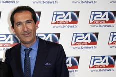 Patrick Drahi, Franco-Israeli businessman and founder of Numericable, poses during a roadshow for the Israel-based broadcast news channel i24 News in Paris March 12, 2014. REUTERS/Benoit Tessier