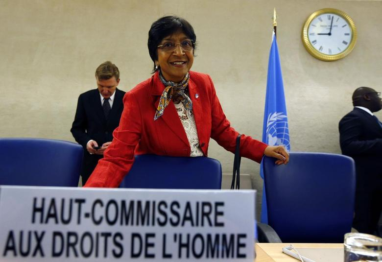 U.N. High Commissioner for Human Rights Navi Pillay arrives for her address to the 25th session of the Human Rights Council at the United Nations in Geneva March 3, 2014. REUTERS/Denis Balibouse