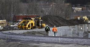 Workers walk on the rail track in Lac-Megantic, November 21, 2013. REUTERS/Mathieu Belanger