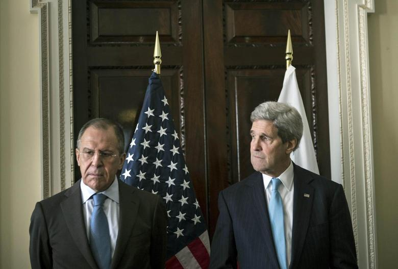 U.S. Secretary of State John Kerry (R) and Russia's Foreign Minister Sergei Lavrov stand together before their meeting at Winfield House, the home of the U.S. ambassador in London March 14, 2014. REUTERS/Brendan Smialowski/pool