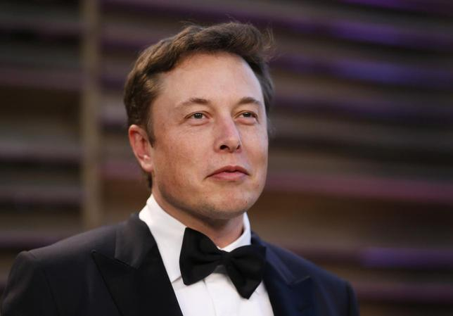 Chief Executive of SpaceX and Tesla Motors Elon Musk arrives at the 2014 Vanity Fair Oscars Party in West Hollywood, California March 2, 2014. REUTERS/Danny Moloshok